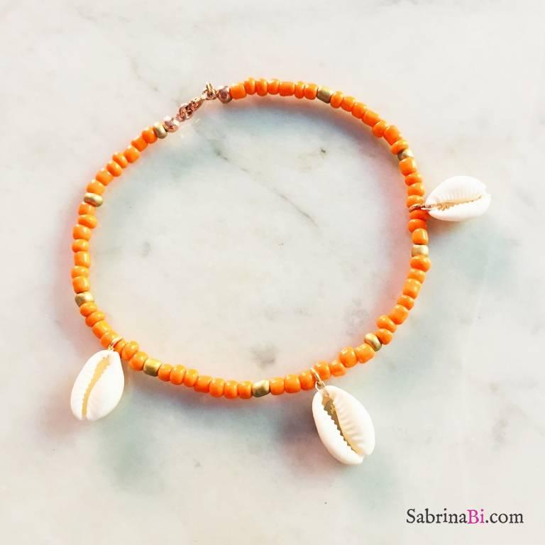 Cavigliera perle di vetro arancioni e oro con conchiglie