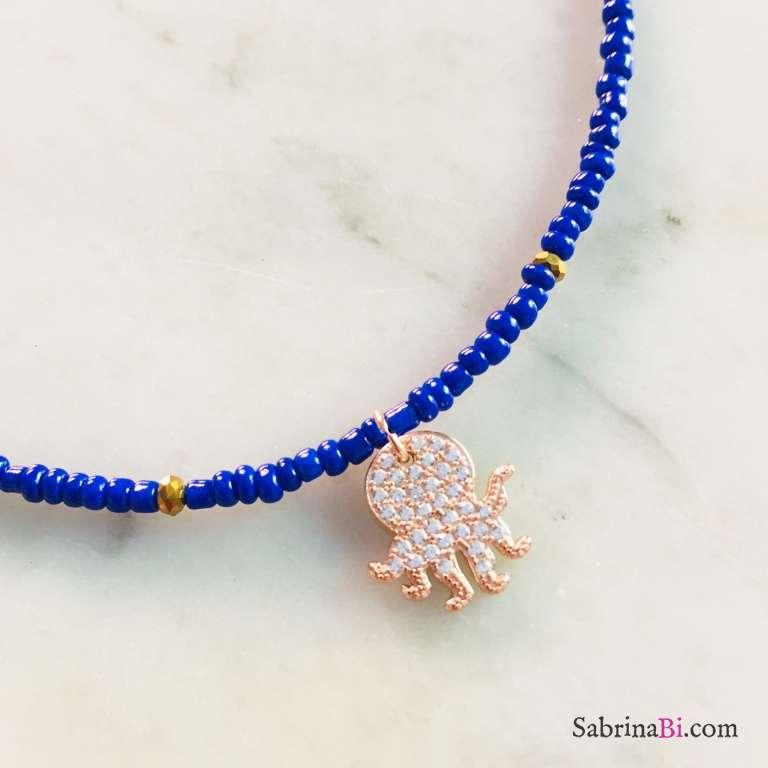 Cavigliera micro perline vetro blu e polpo Zirconi