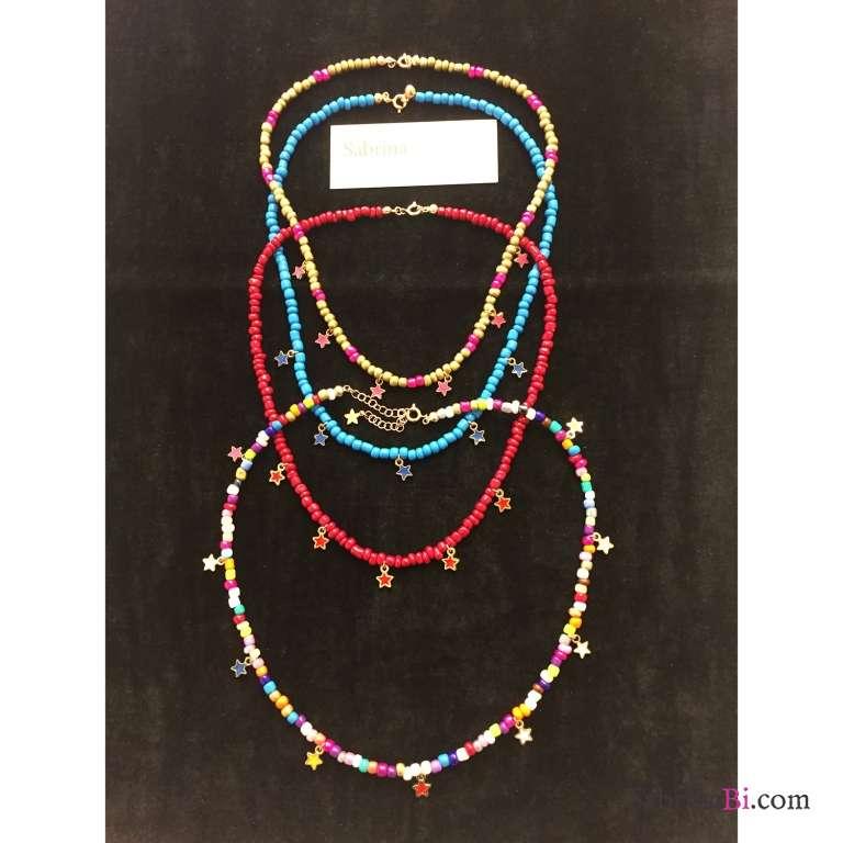 Collana girocollo perle di vetro rosso corallo e stelline