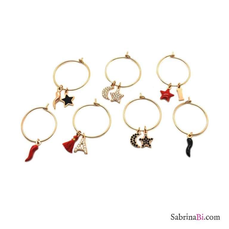 Mono-orecchino a cerchio midi argento 925 oro rosa stella nera e cornetto